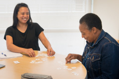 Two women work on literacy activity