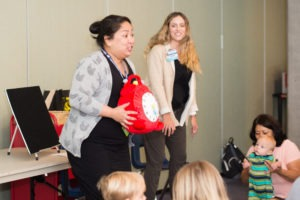 Two literacy specialists lead a child literacy event