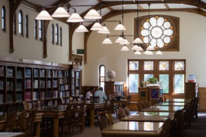 image of library with shelves and tables